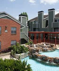 The Lagoon Pool with Cascading Waterfall at Our Hastings Green Apartments in Northwest Houston TX