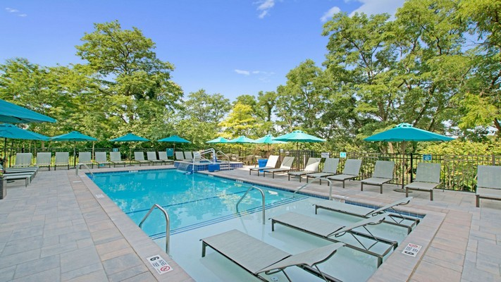 Outdoor image of pool and lounge chairs