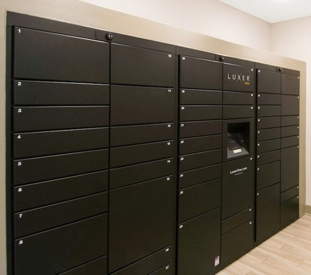 Interior mail room with electronic mailboxes