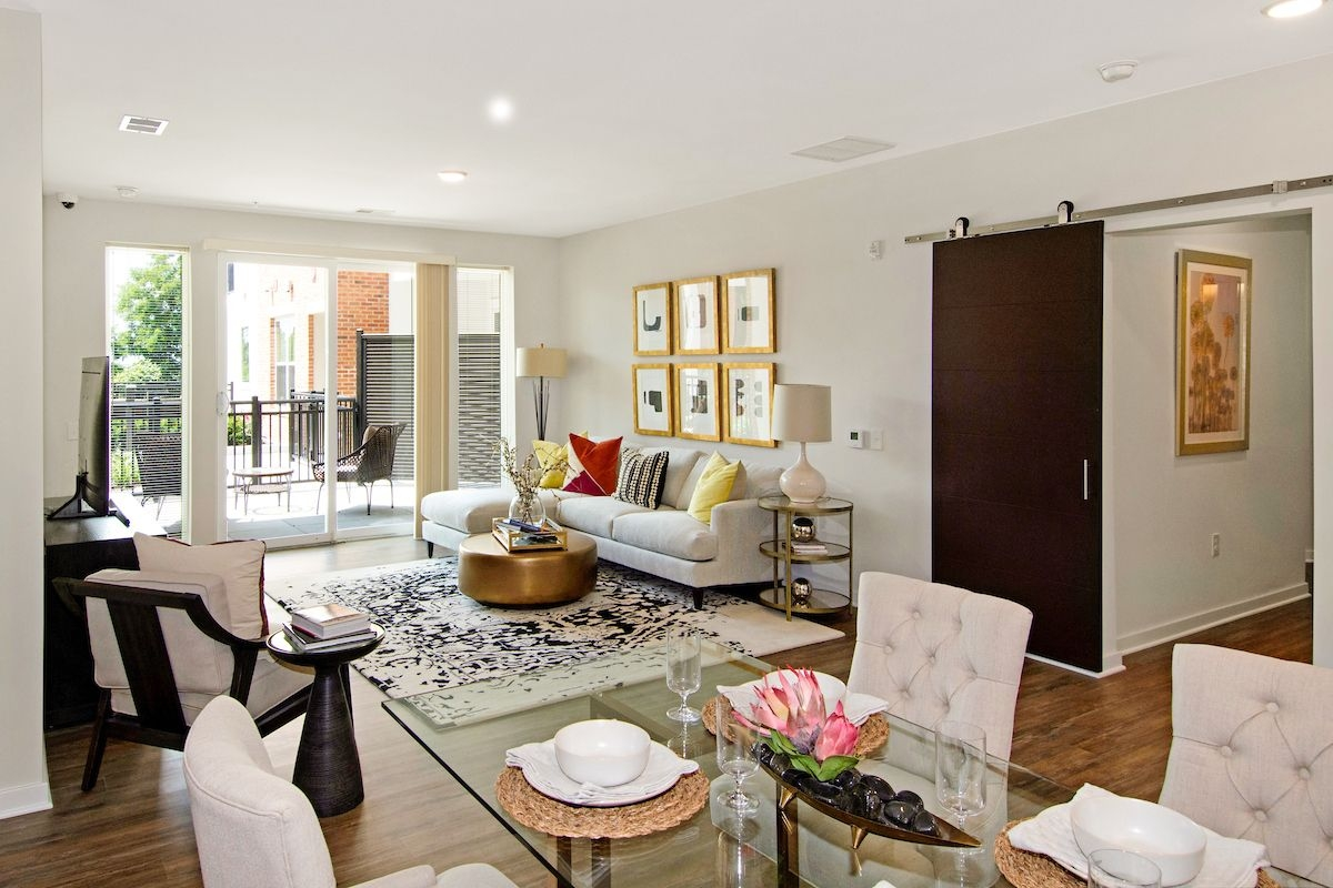 Interior image of living room with furniture and dining table set