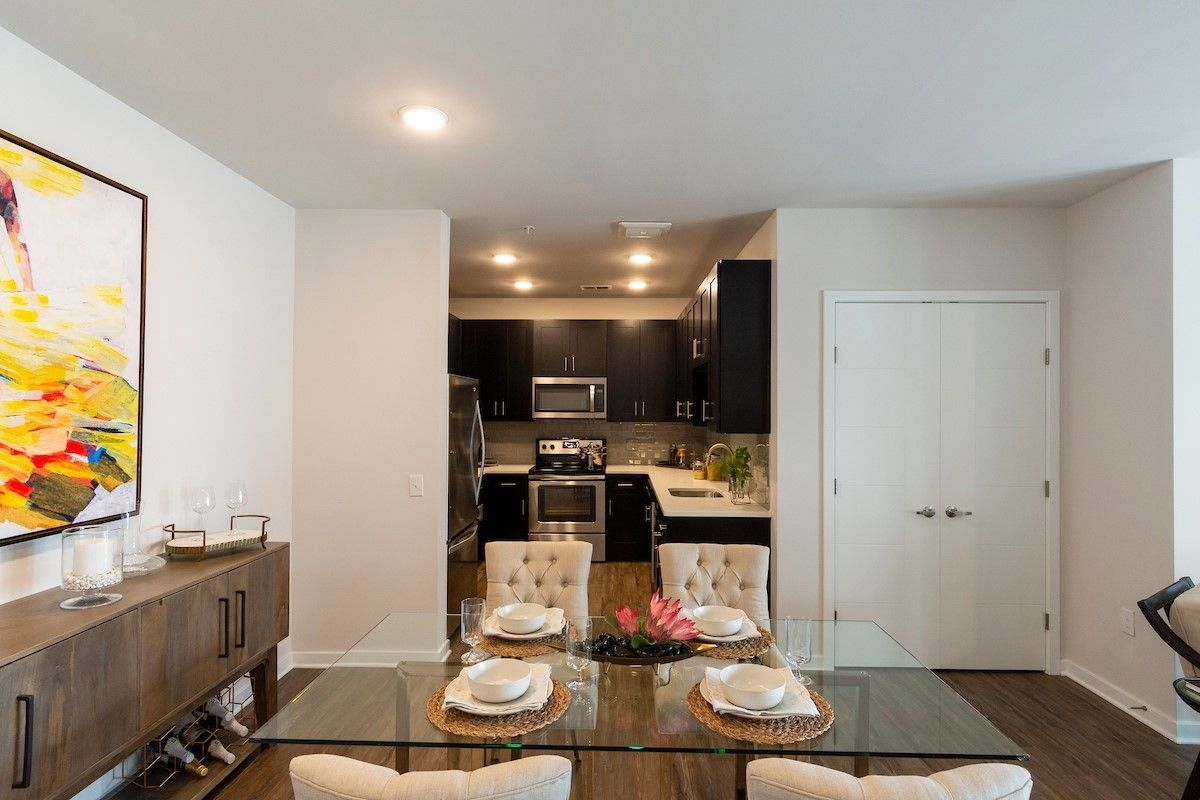 Indoor image of apartment dining table and view of kitchen