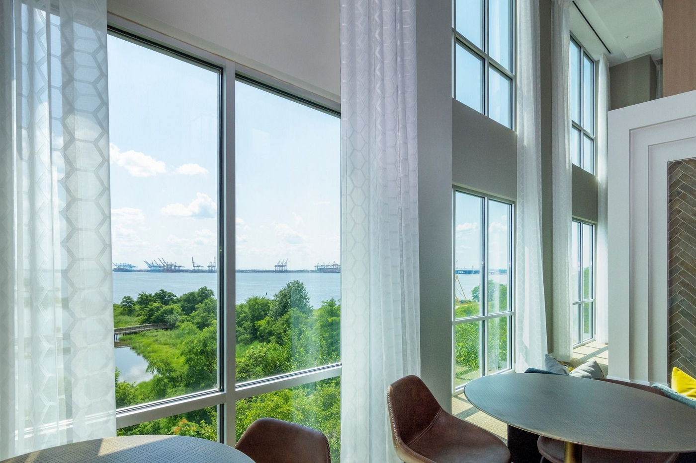 Interior image of club house windows over looking river