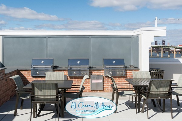 Exterior image of built if BBQ grill with patio dining table