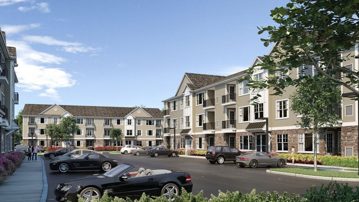 Exterior image of apartment unit and parking lot