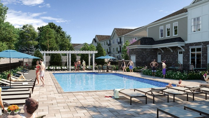 Outdoor image of pool and lounge chairs with umbrella