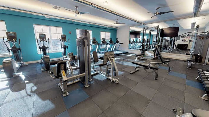 Interior image of fitness room with weight lifting and cardio fitness equipment