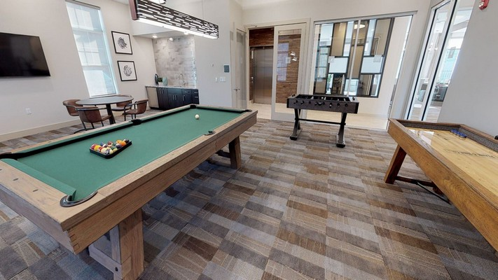 Interior image of resident game room with game tables