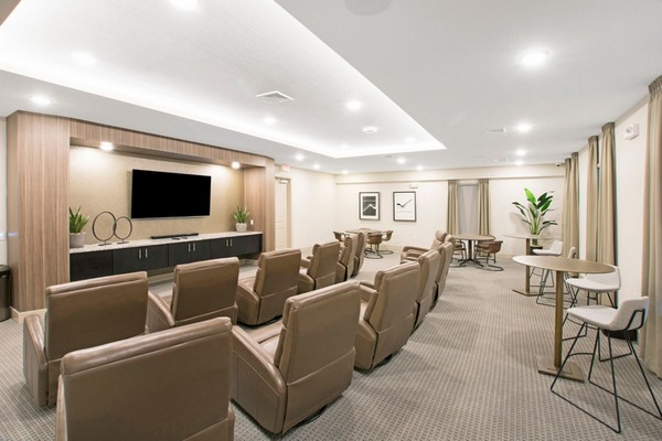Interior image of resident movie room with leather recliners