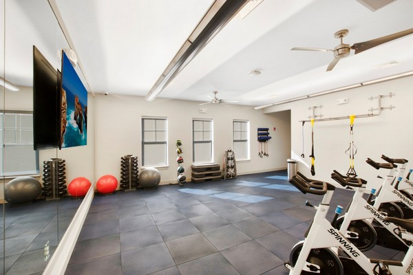 Interior image of fitness room with spin bikes and cardio equipment