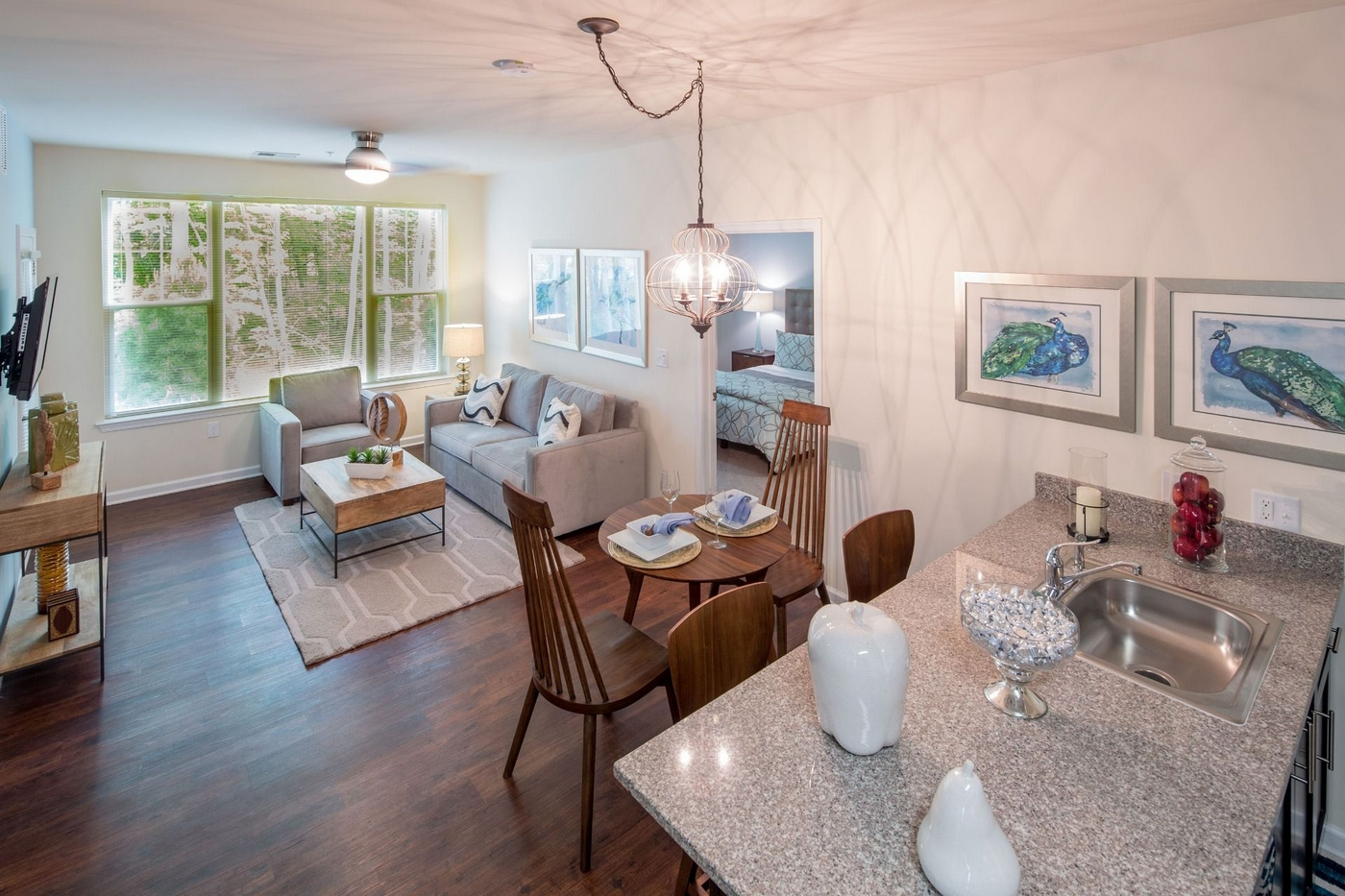 Interior image of kitchen, dining table, and living room furniture