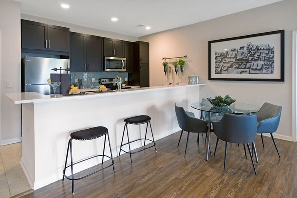 Interior image of kitchen island wood floors, dining table and chairs
