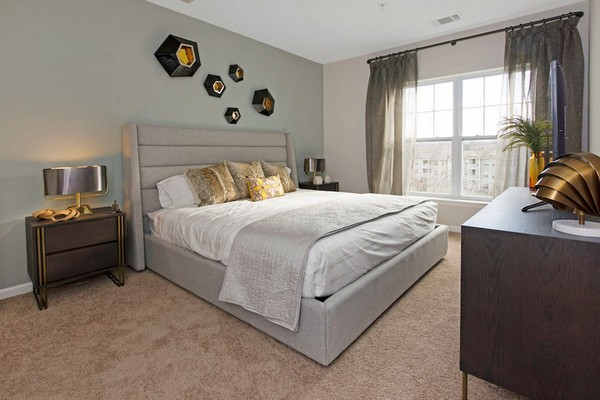 Interior image of an apartment bedroom with bedroom furniture