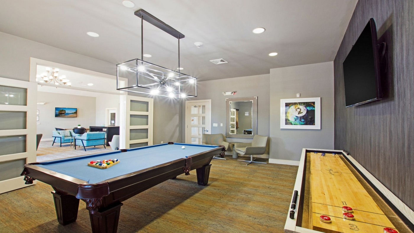 Interior image of community game room with game tables