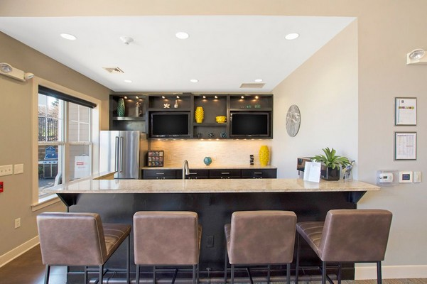 Interior image of community kitchen with bar stools