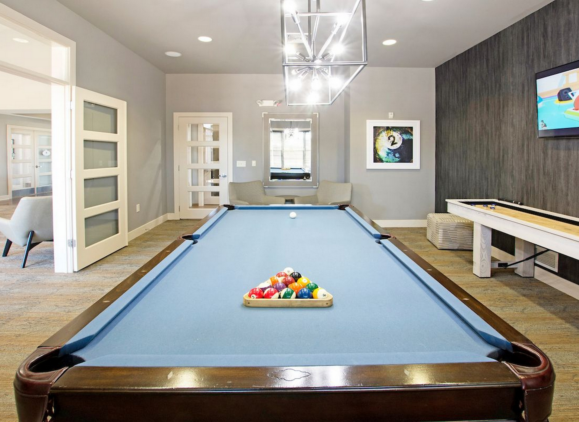 Image of community game room with pool table