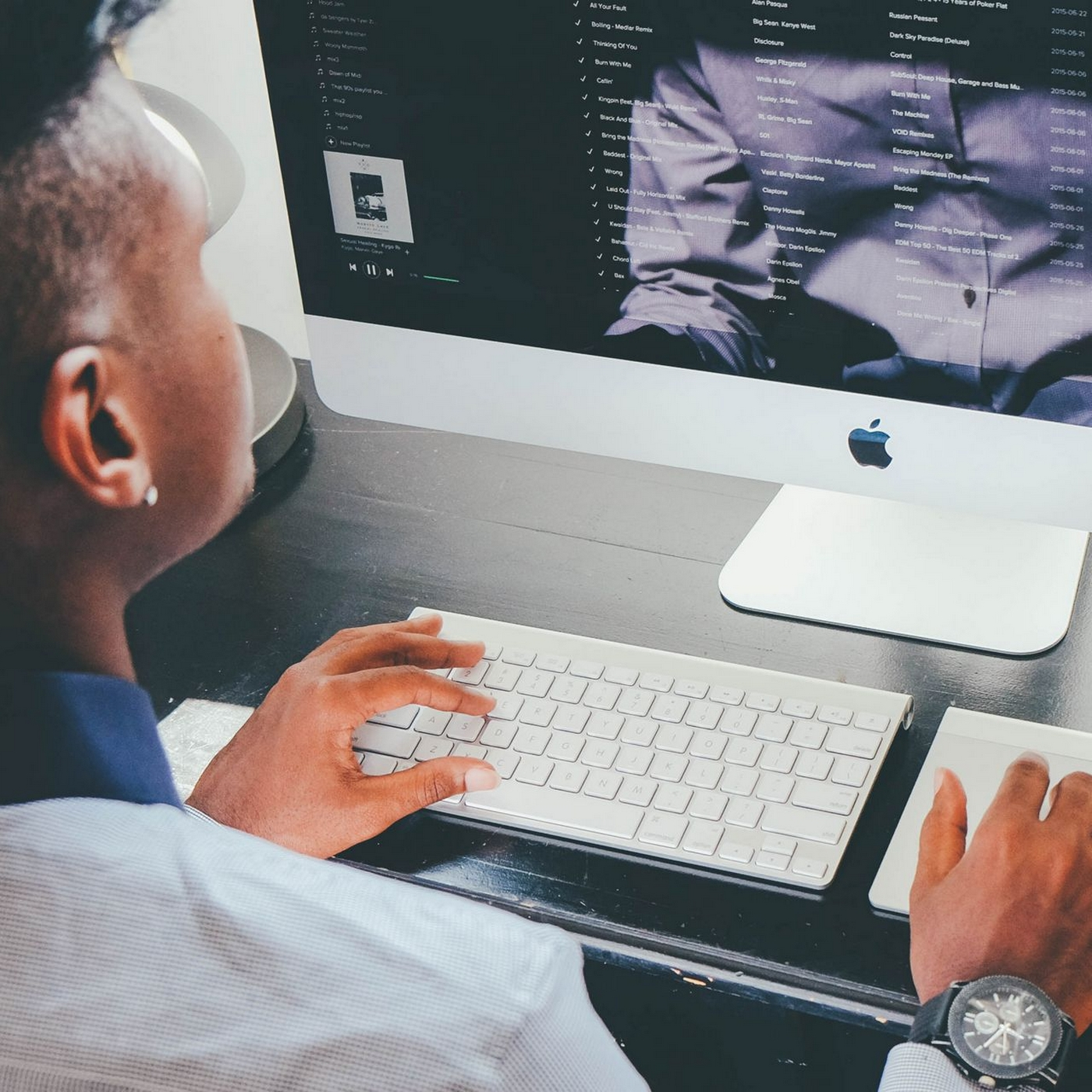 Image of a man working on his desktop