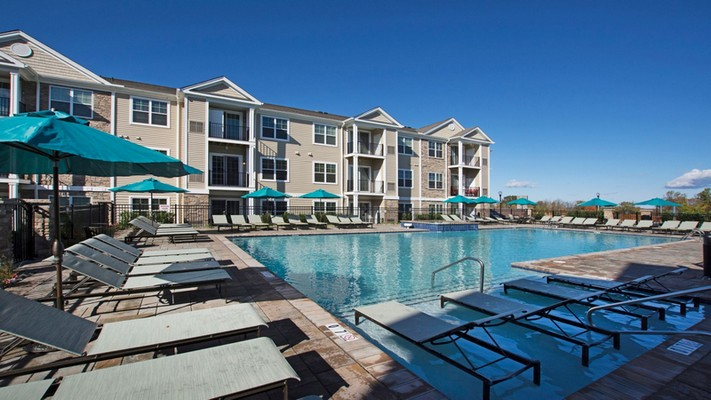 Outdoor image of poolside with exterior apartment unit