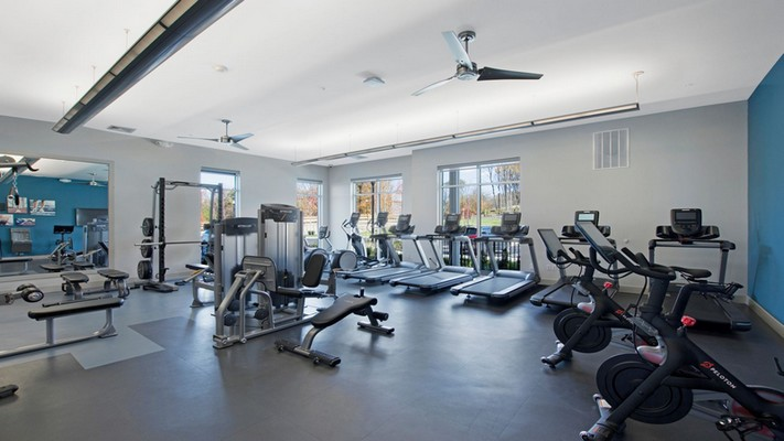 Interior image of onsite fitness room with cardio fitness equipment