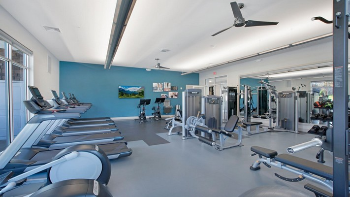 Interior image of fitness room with various cardio and weight lifting equipment