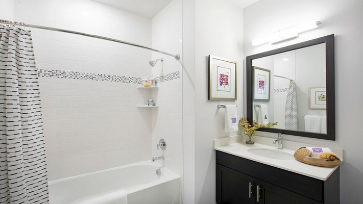 Interior image of a bathroom with mirror and single sink vanity