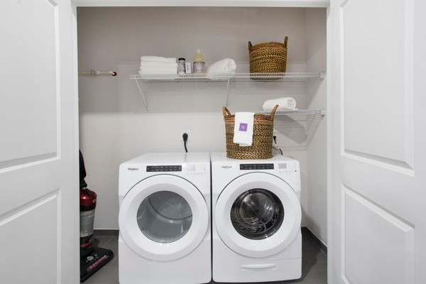 Image of a laundry closet with a washer and dryer
