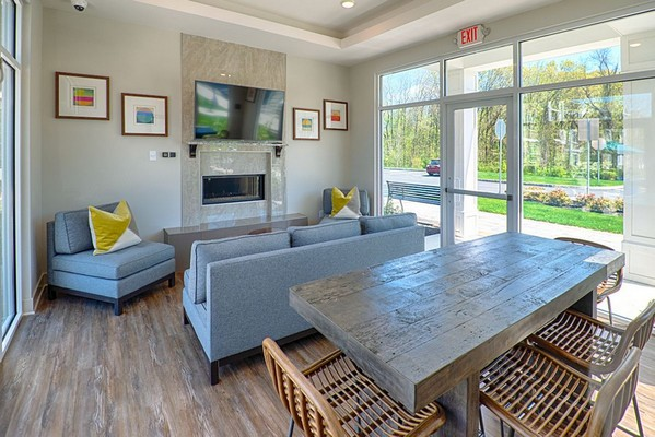 Community indoor seating with fireplace and television