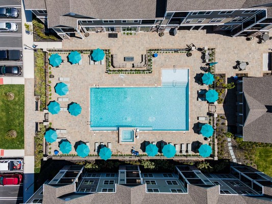 Aerial view of swimming pool and umbrellas
