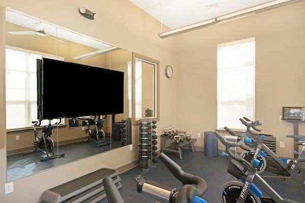 Fitness center with exercise bikes and television