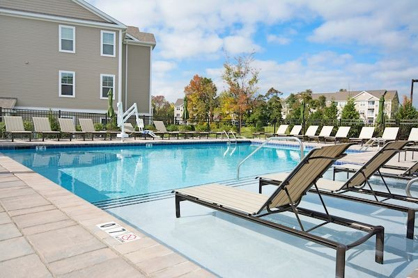 Swimming pool with sundeck and lounge chairs
