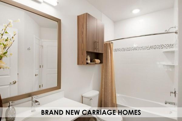 Apartment bathroom with large tub