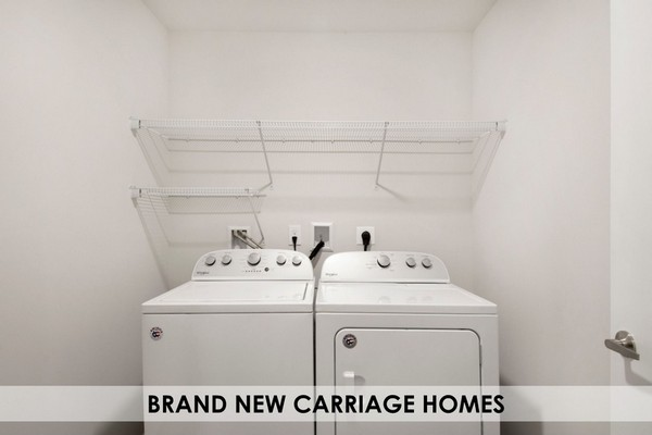 Washer and dryer in laundry room with wire shelving