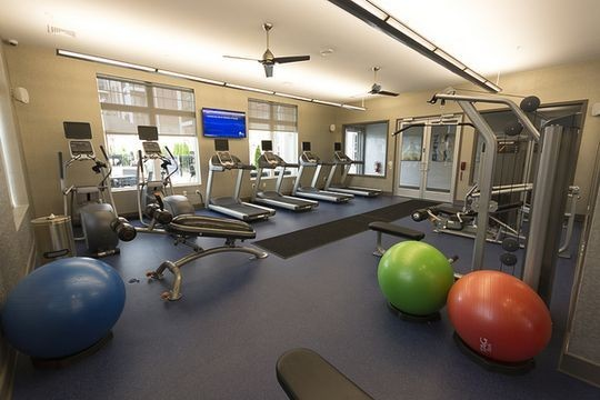 Fitness center with equipment and workout machines