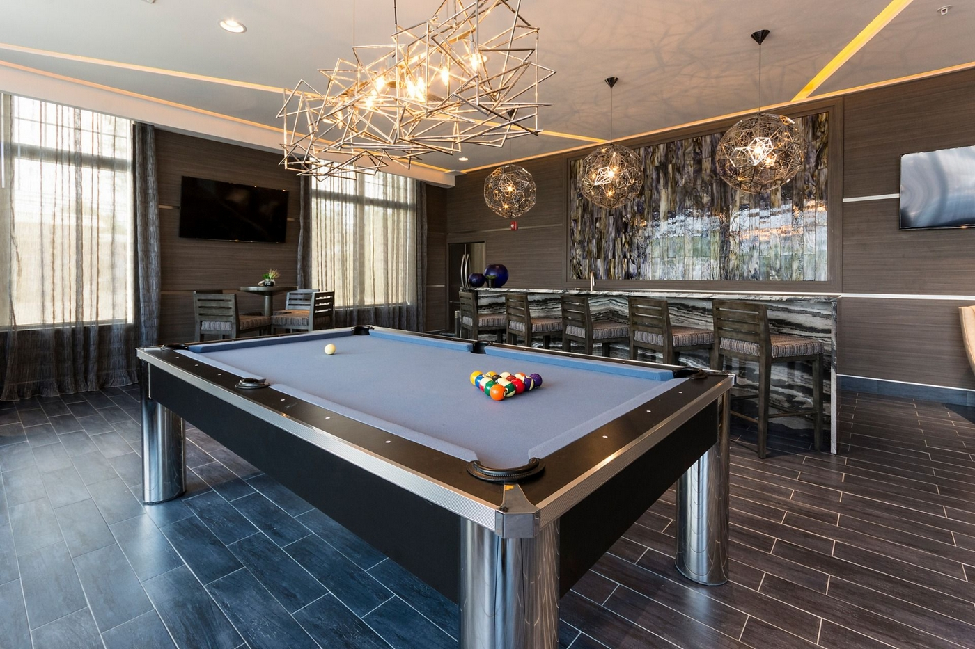Resident lounge area with seating and billiards table