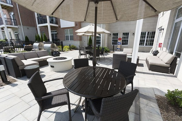 Outdoor lounge area with seating and tables