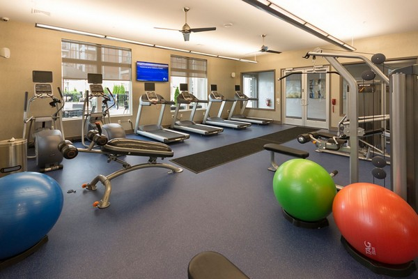 Fitness center with workout machines and equipment
