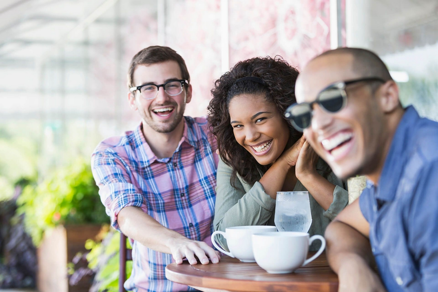 Image of friends laughing drinking coffee