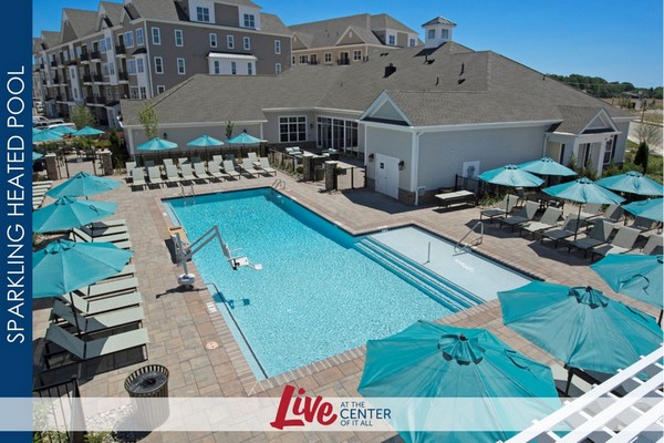 Outdoor aerial view of pool and patio furniture with umbrella