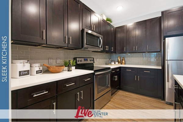 Photo of kitchen with wood cabinets, tile back splash, and stainless appliances