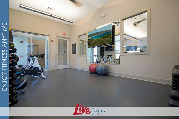 Interior of fitness room with free weights and spin bikes.