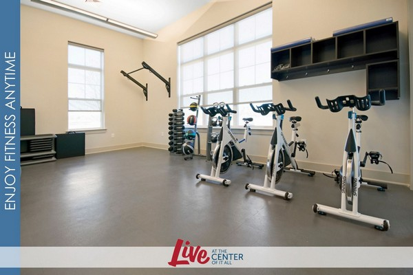 Interior image of cardio exercise area with spin bikes and medicine weighted balls