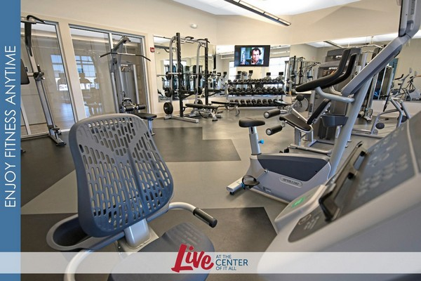 Interior image of onsite gym with weights and athletic equipment