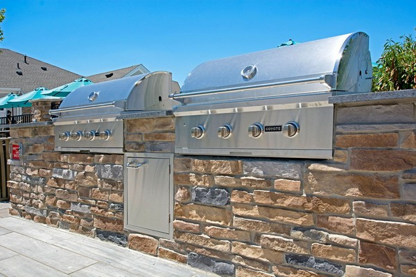 Outdoor image of two built in BBQ grills