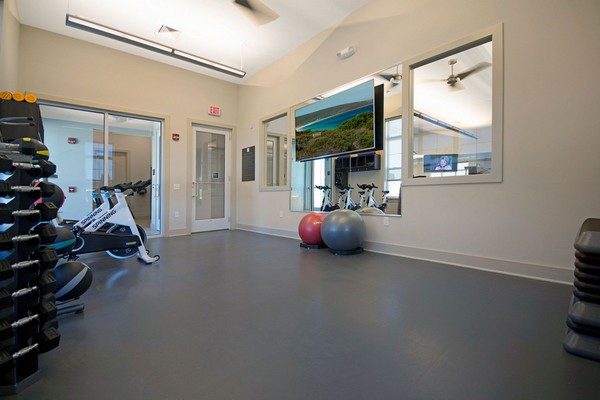 Interior image of fitness room with spin bikes, weighted balls and free weights