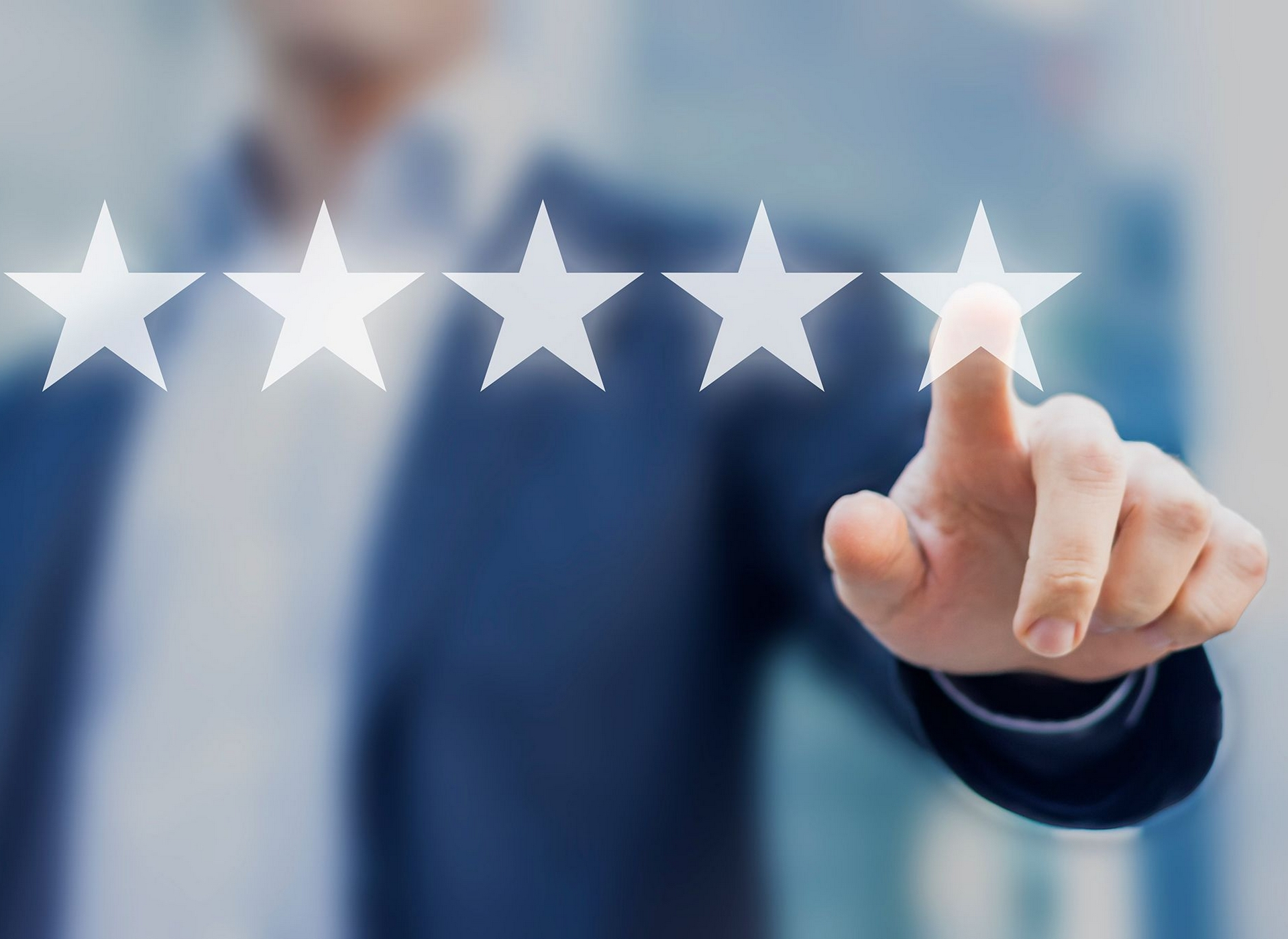 Image of a man with him pressing on five stars for reviews