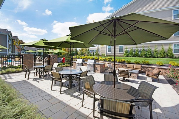 Outdoor tables with large umbrellas