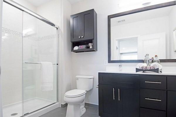 Modern bathroom with large vanity mirror