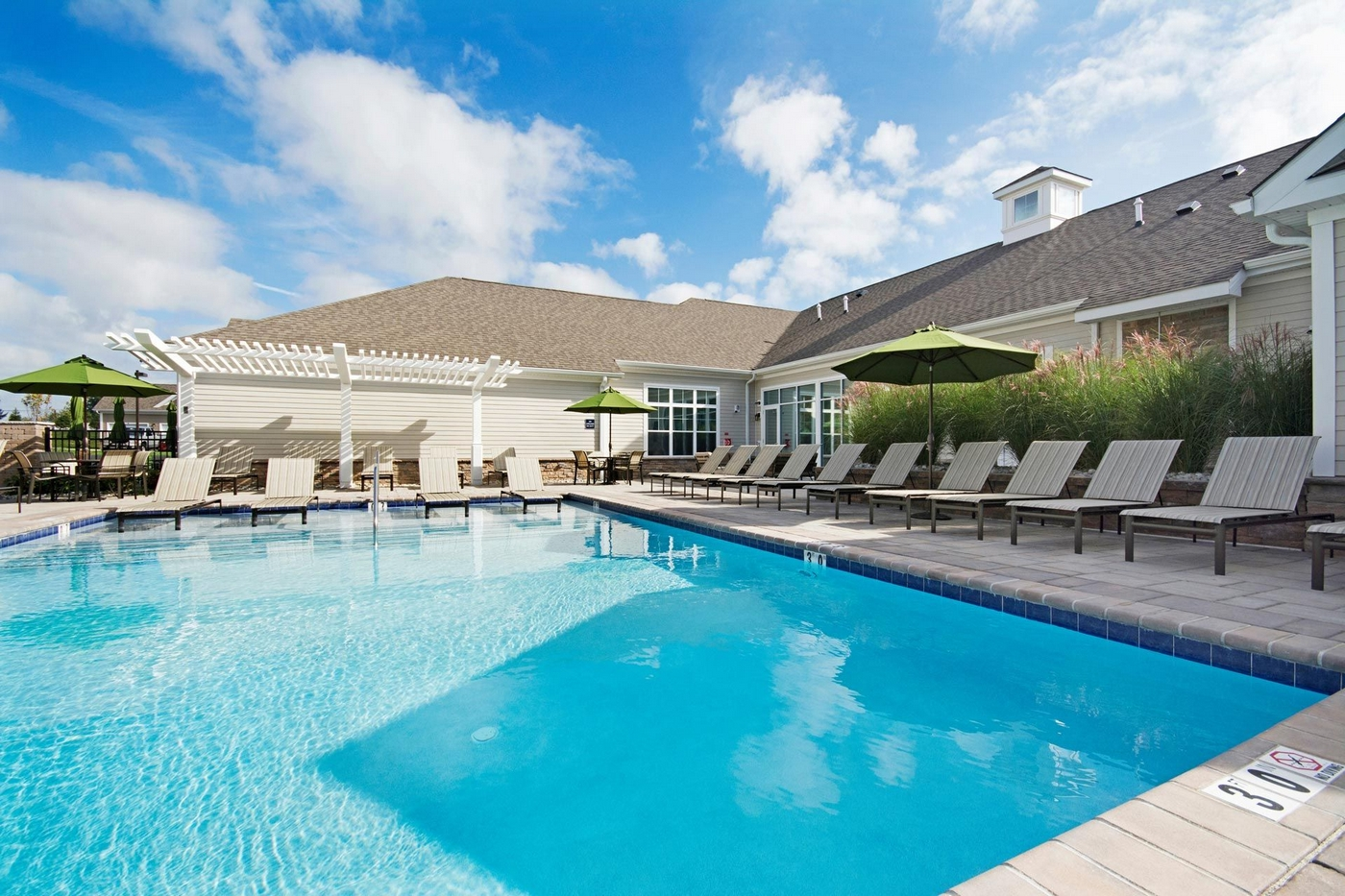 Community swimming pool and poolside lounging