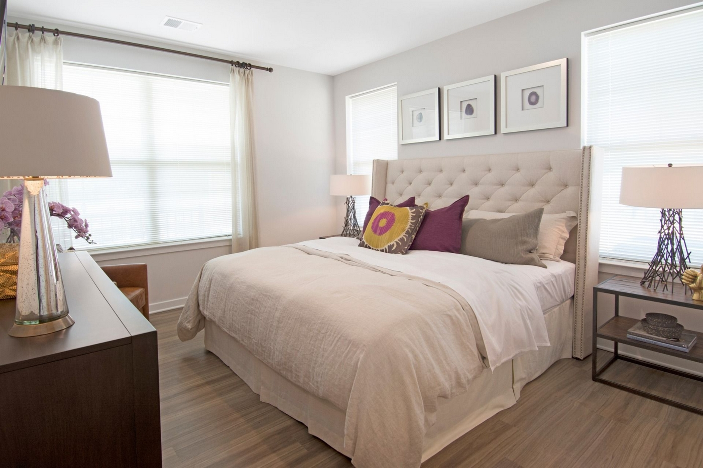 Spacious bedroom with King size bed and wood panel floors