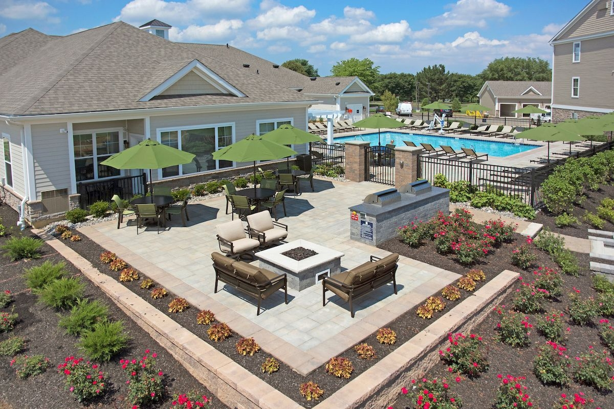 Community poolside grilling and lounging area