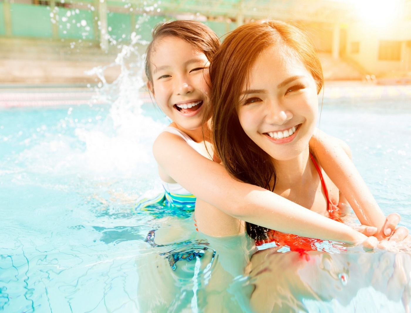 Woman and child in swimming pool
